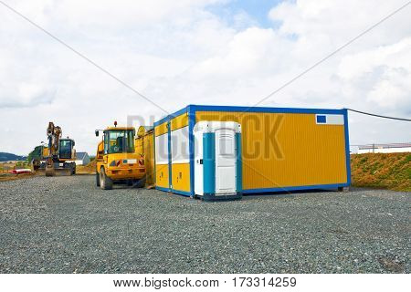 Industrial Site Container and mobile Toilet outdoor Shot
