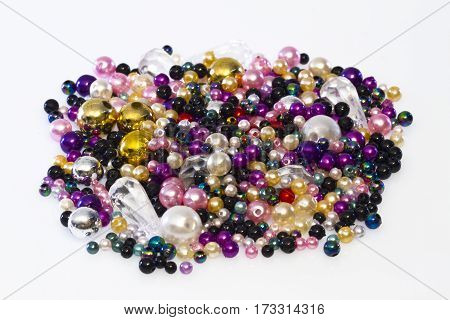 Colorful plastic beads in Detail on bright Background