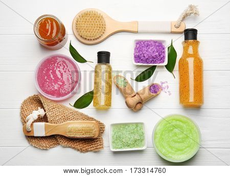 Body care set for peeling on wooden background