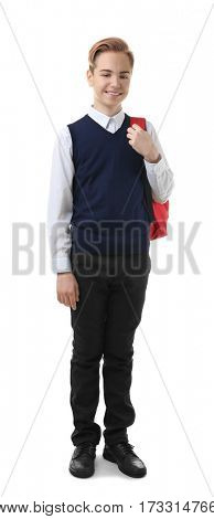 Teenage boy in school uniform with backpack on white background