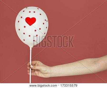 Hands Holding Balloon Heart Decoration