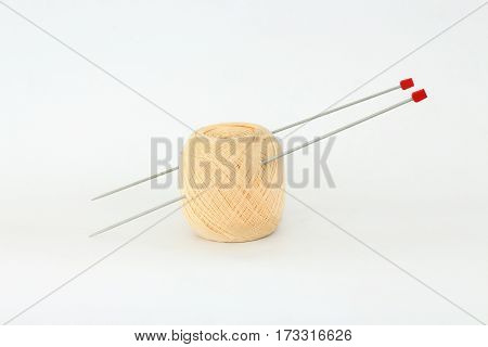 Knitting needles and yarn on a white background.