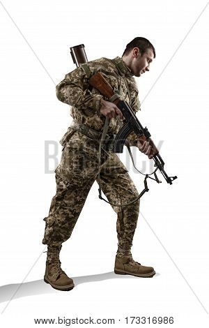sodier in military uniform with machine gun isolated on white background