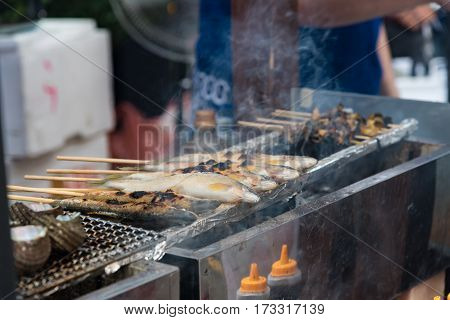 Close up of Japan local fish called ayu sprinkled with salt grilled on charcoal Oita Japan.