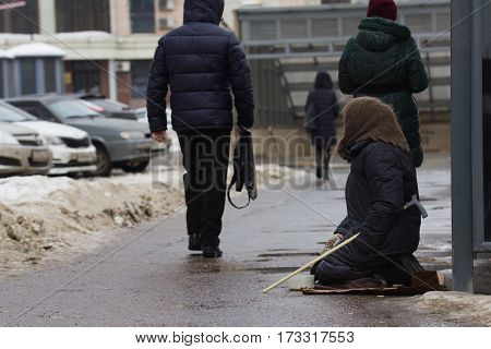 Kazan, Russia, 17 february 2017: Old woman beggars invalid asked money on street, poor disable people, hotizontal