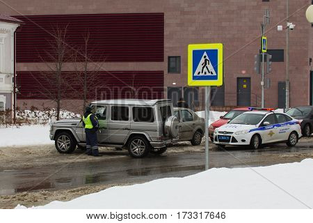 Kazan, Russia- February 21, 2017: Road policemen speaks with owner of expensive car - corruption, telephoto