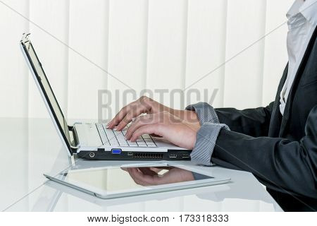 woman in office with laptop com puter