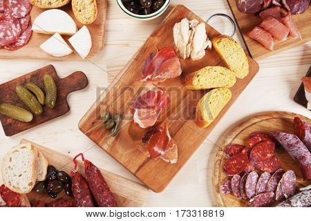 Charcuterie boards with cured meat, bread and olives