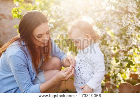 Mother and daughter. Family portrait in backlight. Spring mood. Family time