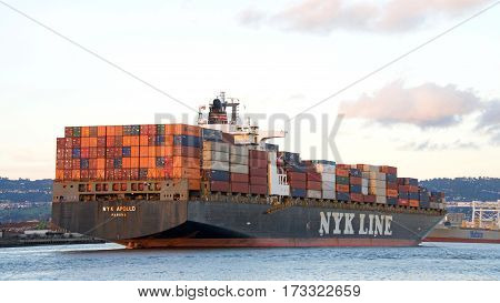 Oakland CA - February 22 2017: Cargo ship NYK APOLLO entering the Port of Oakland.Nippon Yusen Kabushiki Kaisha (NYK) is one of the oldest and largest shipping companies in the world.