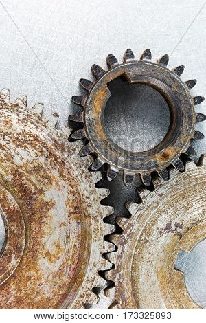 Old Rusty Mechanical Gears On Scratched Metal Background,