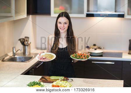 Dieting concept. Healthy Food. Beautiful Young Woman choosing between food