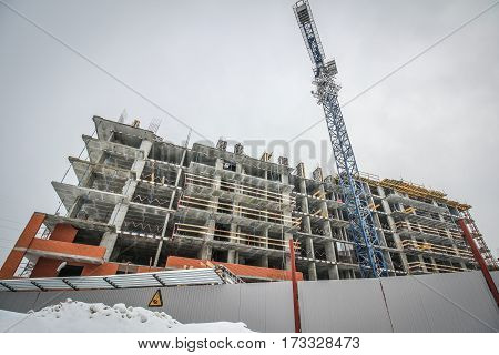Construction of high-rise building in the winter