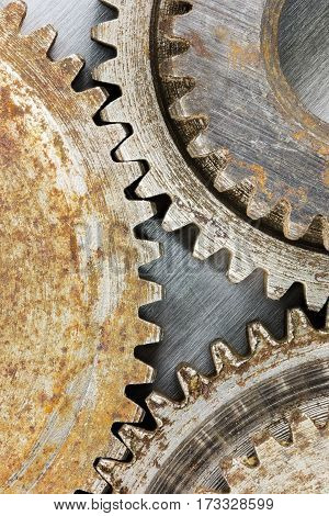 Industrial Old Corroded Gears For Machinery On Scratched Background