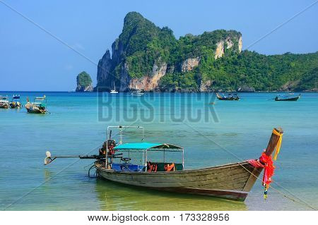 Longtail Boat Anchored At Ao Loh Dalum Beach On Phi Phi Don Island, Krabi Province, Thailand