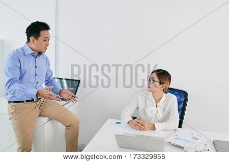 Asian business people discussing ideas at meeting