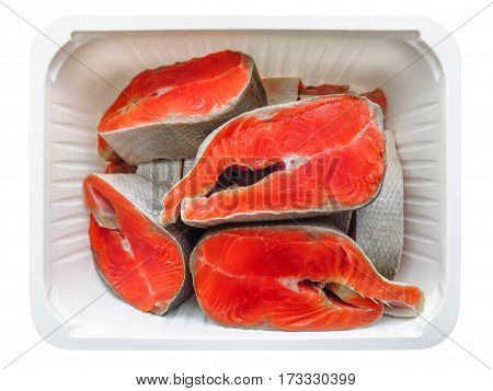 Salmon steaks in the plastic box isolated on white with Clipping Path