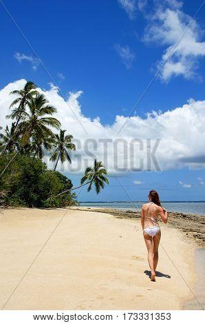 Young Woman In Bikini Walking On The Beach At Makaha'a Island Near Tongatapu Island In Tonga