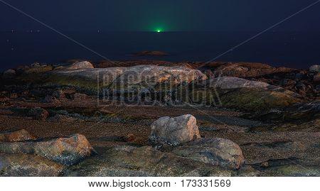 Rocks at seaside with twilight blue sky.