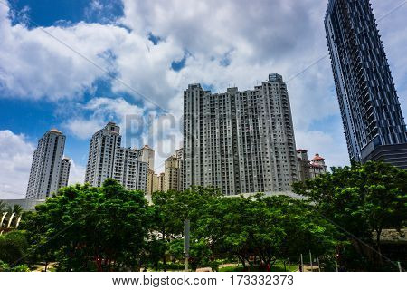 High rise building like a skycraper surrounding with green trees and beautiful clear sky as background photo taken in Jakarta Indonesia java