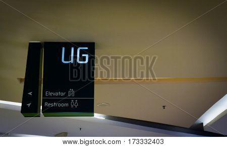 A sign board to UG - Upper Ground Floor hanging on ceiling at Central Park Mall photo taken at Jakarta Indonesia java