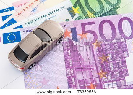 Toy car on euro notes