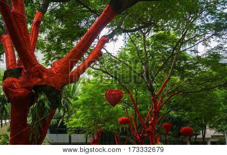 tree decoration with red tape and lampion for Chinese New Year Celebration at Central Park Mall photo taken in Jakarta Indonesia java
