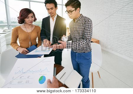 First person view of businessman conducting meeting with colleagues