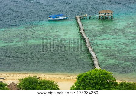 Long Wooden Jetty At Kanawa Island In Flores Sea, Nusa Tenggara, Indonesia
