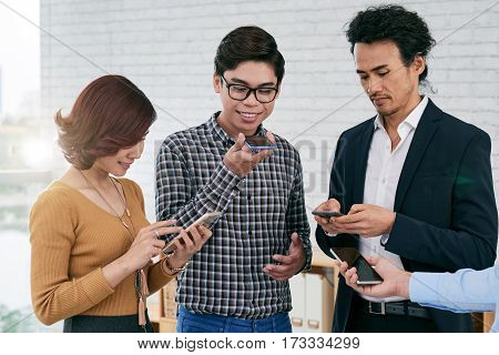Young businessman using voice search on his smartphone poster
