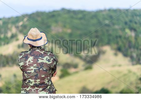 Soldier or Forest officials looking at moutain in the big forest with day light.