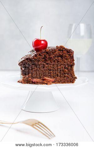 Chocolate cake with juicy cherries