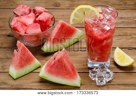 Juicy Slices Of Watermelon And A Glass Of Pialki With Watermelon Slices, Close-up On A Brown Wooden