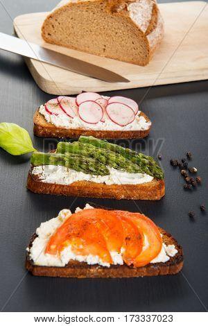 Three different sandwich on wooden board