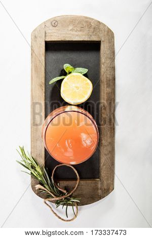 Grapefruit drink with ice cubes