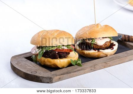 Two different fresh tasty burgers