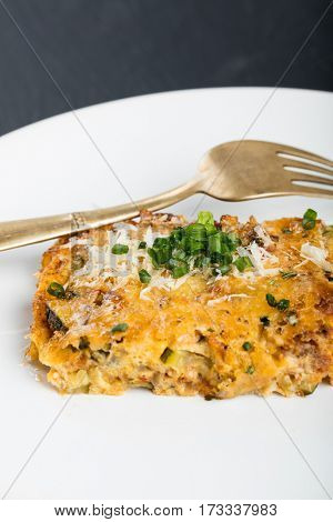 Vegetables casserole with cheese and chives