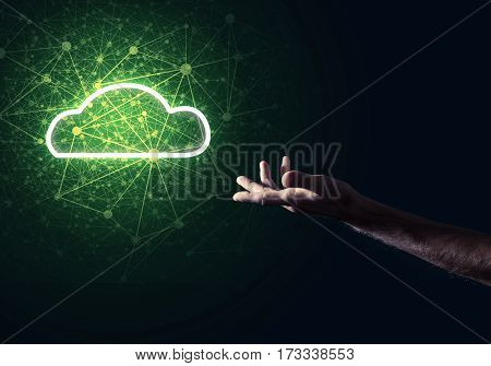 Male hand pointing to a cloud computer concept