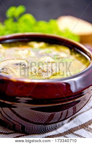 Soup With Meatballs And Mushrooms In Clay Bowl On Dark Board