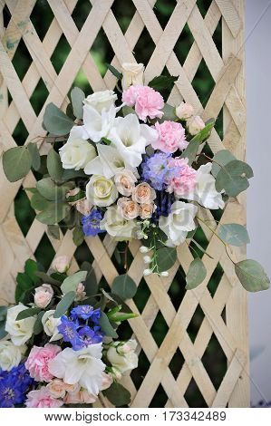 Beautiful wedding trellis decorated with white, purple and pink flowers, outdoor
