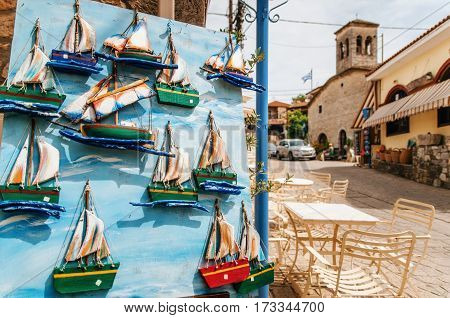 Afitos Halkidiki Greece - May 22 2015: Wooden colorful souvenirs in the form of sailing boat in the Greek resort Afitos Halkidiki Greece