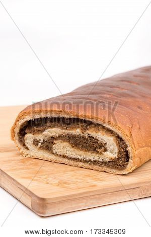 Strudel With Walnuts On The Wooden Board
