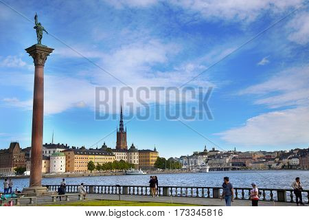 STOCKHOLM SWEDEN - AUGUST 20 2016: Tourists walk and visit Stockholm City Hall ( Stadshuset ) and View of Gamla Stan in Stockholm Sweden on August 20 2016.