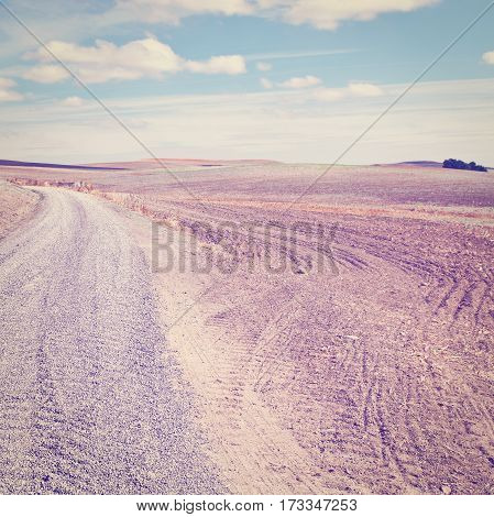 Gravel Road between Plowed Fields in Spain Instagram Effect