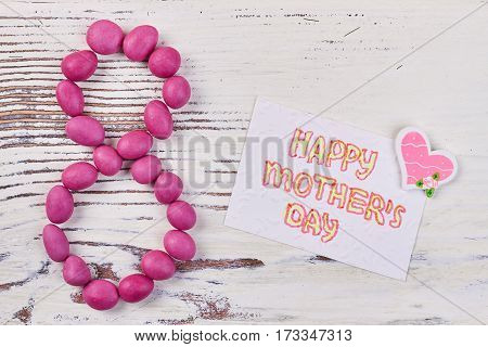 Candies and greeting card. Best wishes at Mother's day.