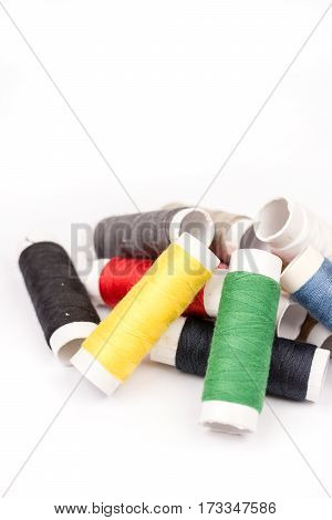 Pile Of Colorful Threads Over White Background