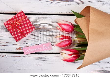 Tulip flowers and box. Pleasant gift for women's day.