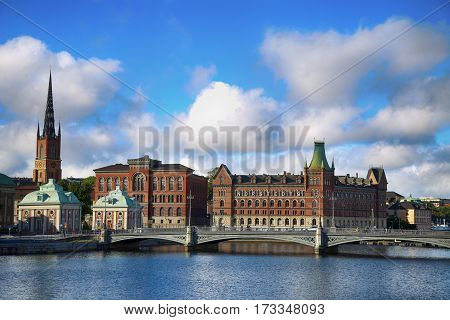 STOCKHOLM SWEDEN - AUGUST 19 2016: Beautiful View of church Riddarholm Church and Centralbron street (Riddarholmen) from bridge Riksbron in Stockholm Sweden on August 19 2016.