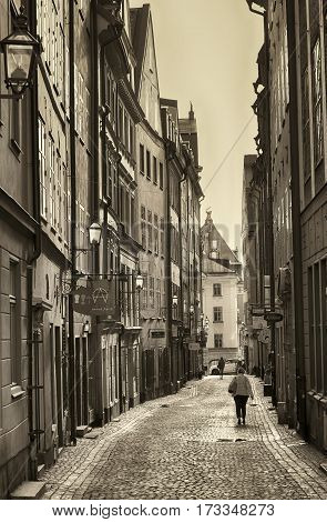 STOCKHOLM SWEDEN - AUGUST 19 2016: View of narrow street and colorful buildings Kopmangatan street located in Gamla Stan old town in central Stockholm Sweden on August 19 2016.