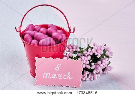 Card, flowers, bucket and confectionery. Women who inspire.